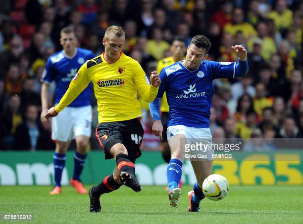 Watford's Joel Ekstrand and Leicester City's David Nugent battle for the ball during the npower Football League Championship match at Vicarage Road