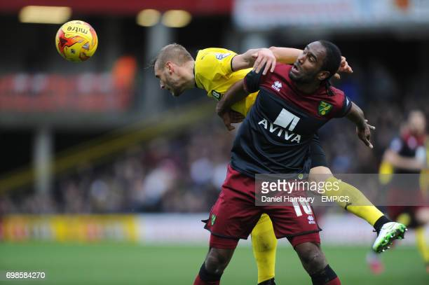 Watford's Joel Ekstrand and Norwich City's Cameron Jerome battle for the ball