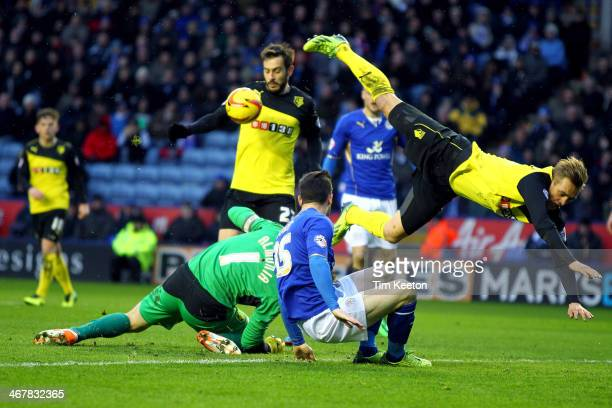 Watford's Joel Ekstrand clatters into his own keeper Manuel Almunia as Leicester City's David Nugent puts pressure on during the Sky Bet Championship...