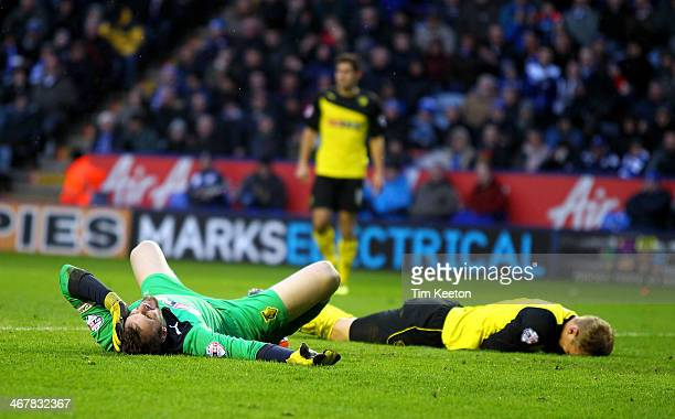 Watford's Joel Ekstrand clatters into his own keeper Manuel Almunia during the Sky Bet Championship match between Leicester City and Watford at The...
