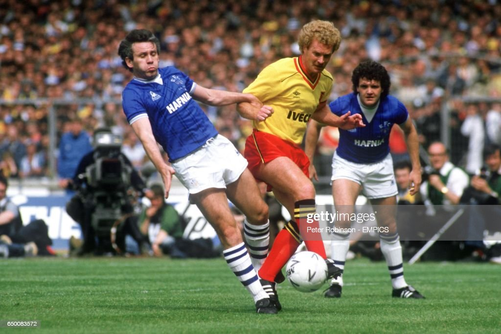 Watford's Les Taylor (right) holds of Everton's Peter Reid