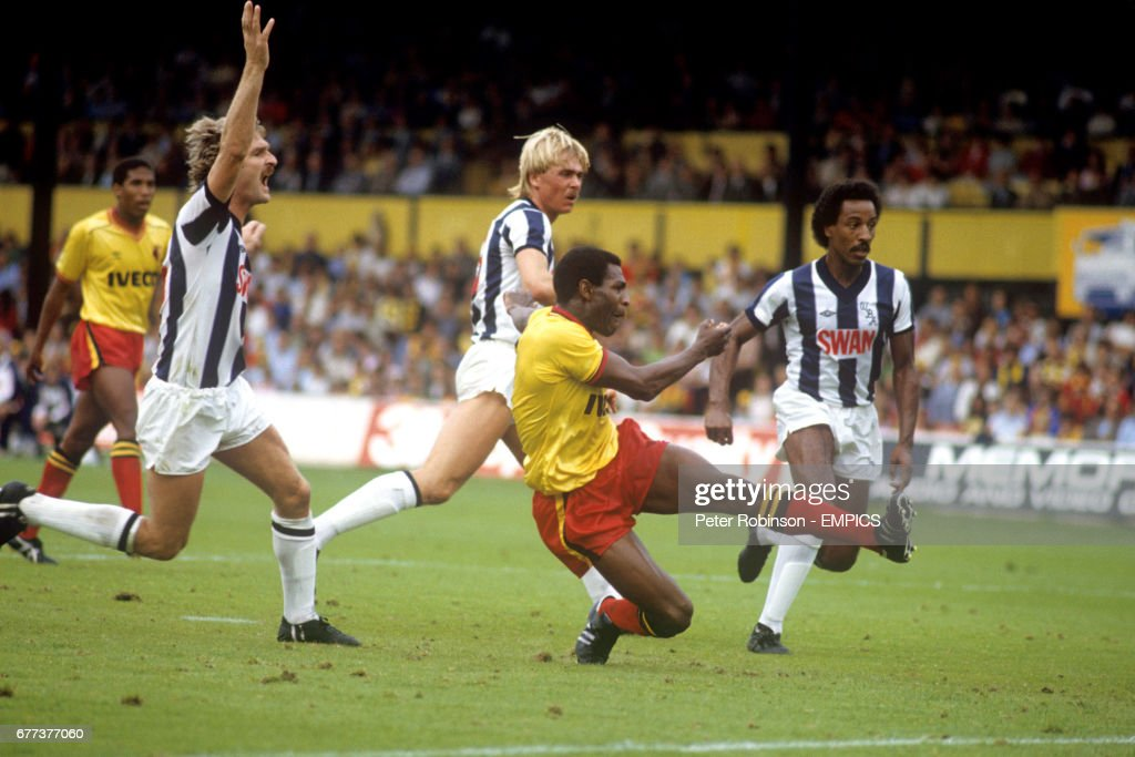 Watford's Luther Blissett (second r) fires home one of his two goals, watched by West Bromwich Albion's Ally Robertson (l), Martyn Bennett (second l) and Brendon Batson