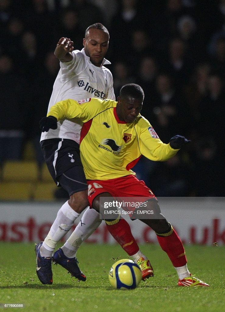 Watford's Marvin Sordell and Tottenham Hotspur's Younes Kaboul