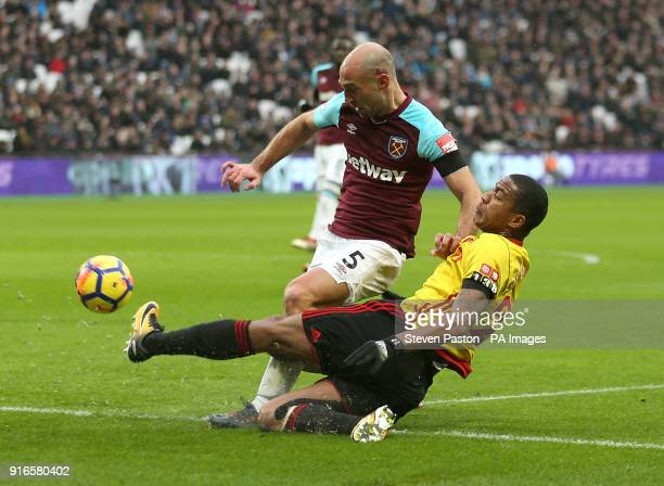 Watford's Marvin Zeegelaar and West Ham United's Pablo Zabaleta battle for the ball during the Premier League match at London Stadium