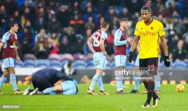 BURNLEY ENGLAND DECEMBER Watford's Marvin Zeegelaar leaves the field after being shown the red card during the Premier League match between Burnley...