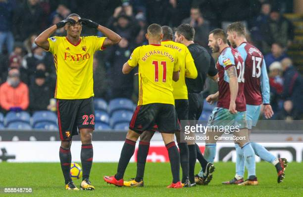 Watford's Marvin Zeegelaar reacts after being sent off by referee Lee Probert during the Premier League match between Burnley and Watford at Turf...