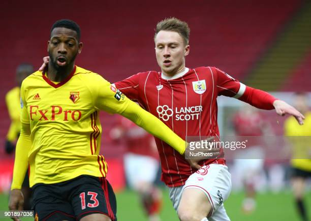 LR Watford's Molla Wague and Bristol City's Cauley Woodrow during FA Cup 3rd Round match between Watford and Bristol City at Vicarage Road Stadium...