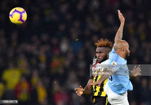 Watford's Nigerian striker Isaac Success vies with Manchester City's English midfielder Fabian Delph during the English Premier League football match...