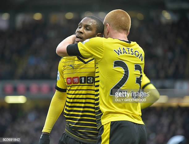 Watford's Nigerian striker Odion Ighalo celebrates with Watford's English midfielder Ben Watson after scoring their first goal during the English...