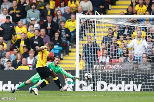 Watford's Nigerian striker Odion Ighalo misses an open goal by Manchester United's Spanish goalkeeper David de Gea during the English Premier League...
