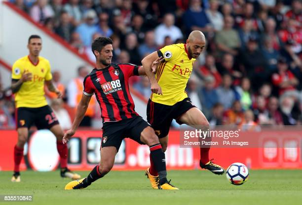 Watford's Nordin Amrabat and AFC Bournemouth's Andrew Surman battle for the ball during the Premier League match at the Vitality Stadium Bournemouth