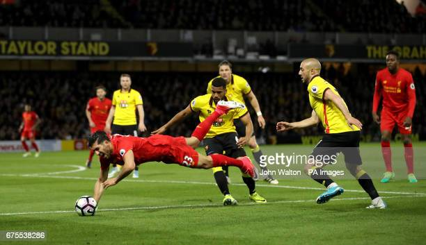 Watford's Nordin Amrabat and Liverpool's Emre Can battle for the ball during the Premier League match at Vicarage Road London