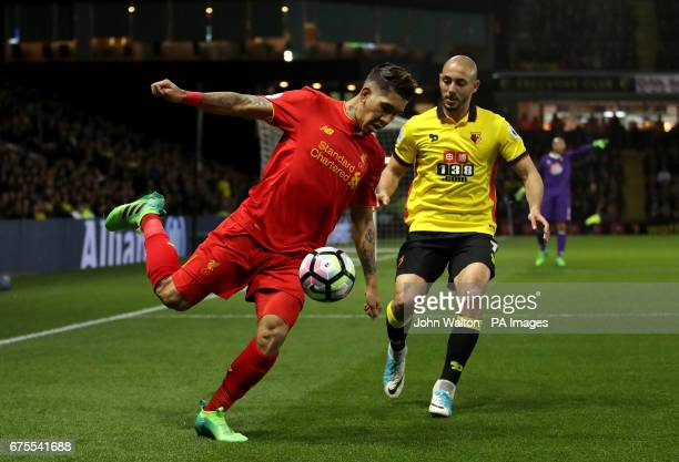 Watford's Nordin Amrabat and Liverpool's Roberto Firmino battle for the ball during the Premier League match at Vicarage Road London