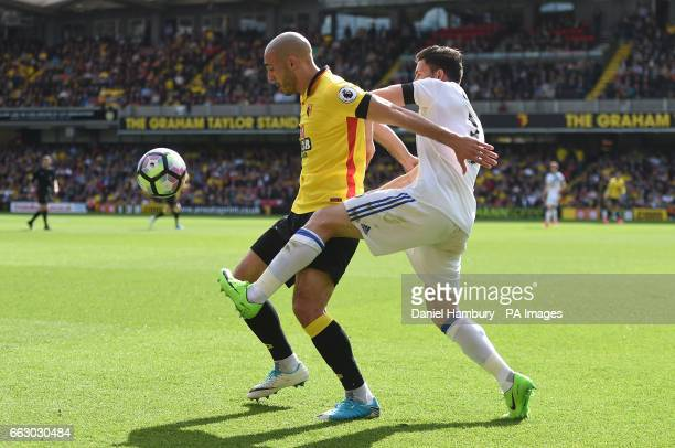Watford's Nordin Amrabat and Sunderland's Bryan Oviedo battle for the ball during the Premier League match at Vicarage Road Watford