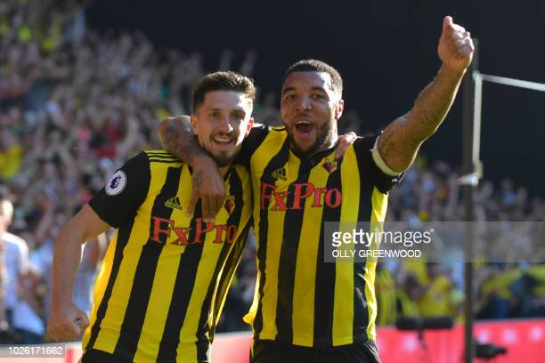 Watford's Northern Irish defender Craig Cathcart celebrates with Watford's English striker Troy Deeney after scoring their second goal during the...