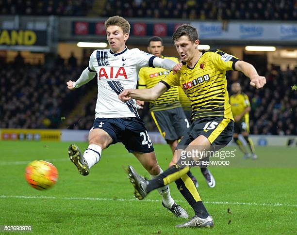 Watford's Northern Irish defender Craig Cathcart vies with Tottenham Hotspur's English midfielder Tom Carroll during the English Premier League...