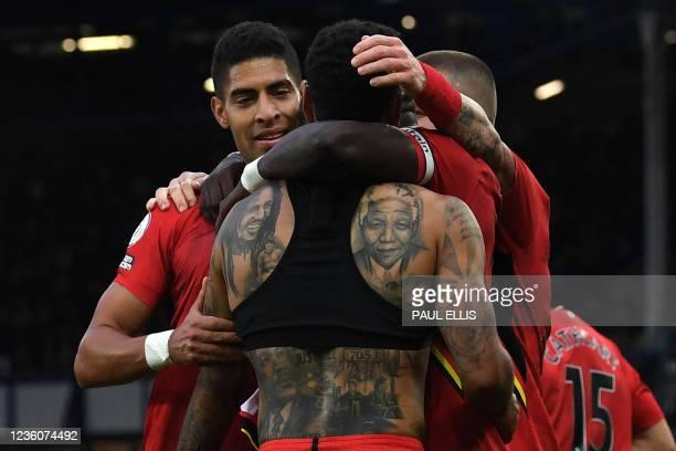 Watford's Norwegian striker Joshua King , features tattoos of singer Bob Marley, , statesman Nelson Mandela , civil rights activist Martin Luther...