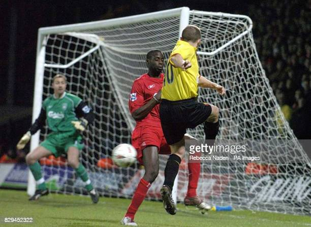 Watford's Paul Devlin beats Liverpool's Djimi Traore but fails to score