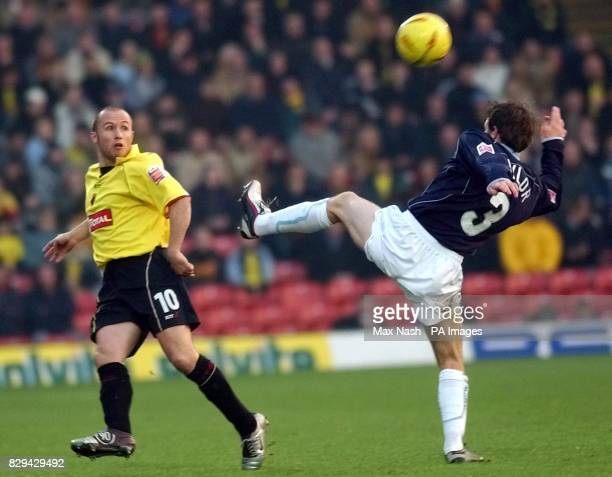 Watford's Paul Devlin challenges Wolverhampton Wanderers Lee Naylor for the ball during the CocaCola Championship match at Vicarage Road Watford...