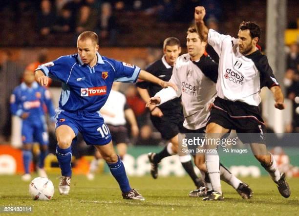 Watford's Paul Devlin gets away from Fulham's Sylvain Legwinski