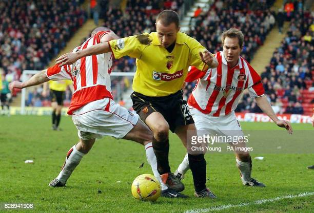 Watford's Paul Devlin gets past Stephen Wright and Jason McAteer of Sunderland during the Nationwide Division One match at Vicarage Road Watford THIS...