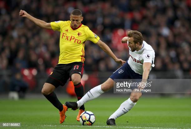 Watford's Richarlison and Tottenham Hotspur's Harry Kane battle for the ball during the Premier League match at Wembley Stadium London