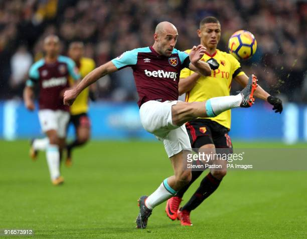 Watford's Richarlison and West Ham United's Pablo Zabaleta battle for the ball during the Premier League match at London Stadium