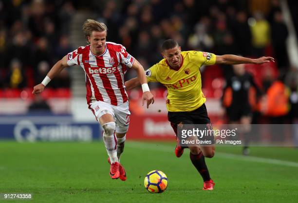 Watford's Richarlison battle for the ball with Stoke City's Moritz Bauer during the Premier League match at the bet365 Stadium Stoke