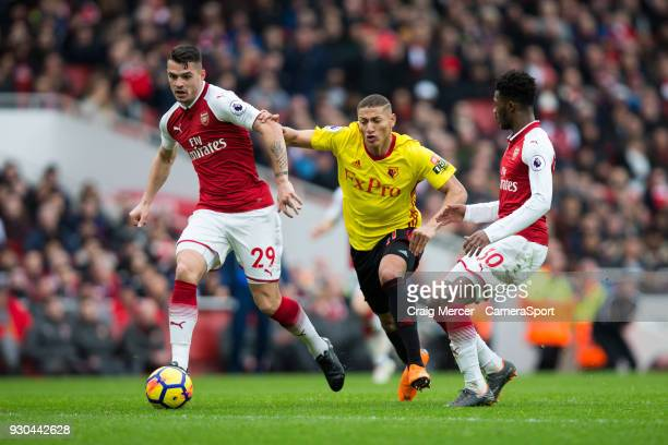 Watford's Richarlison battles for possession with Arsenal's Granit Xhaka during the Premier League match between Arsenal and Watford at Emirates...