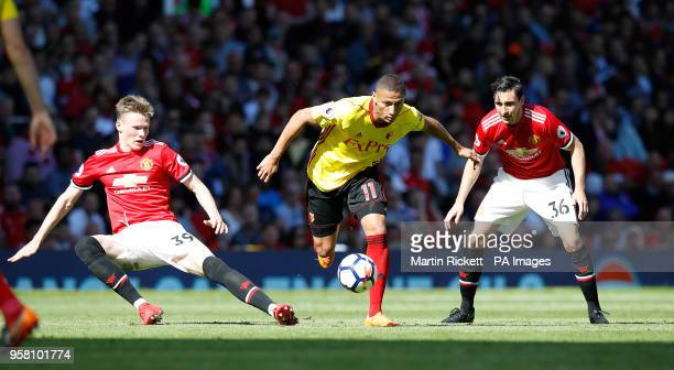 Watford's Richarlison battles for the ball with Manchester United's Scott McTominay and Matteo Darmian during the Premier League match at Old...