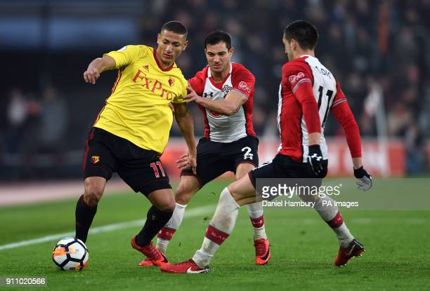 Watford's Richarlison battles for the ball with Southampton's Cedric Soares and Dusan Tadic during the Emirates FA Cup fourth round match at St...