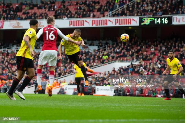 Watford's Richarlison gets a header on goal during the Premier League match between Arsenal and Watford at Emirates Stadium on March 11 2018 in...