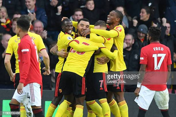 Watford's Senegalese midfielder Ismaila Sarr celebrates with teammates after scoring the opening goal of the English Premier League football match...