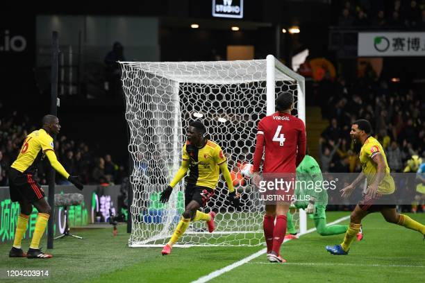 Watford's Senegalese midfielder Ismaila Sarr celebrates with teammates after he scores the team's first goal during the English Premier League...