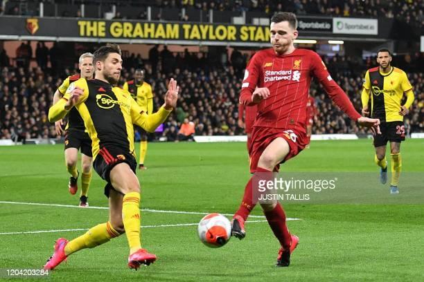 Watford's Spanish defender Kiko Femenia vies with Liverpool's Scottish defender Andrew Robertson during the English Premier League football match...
