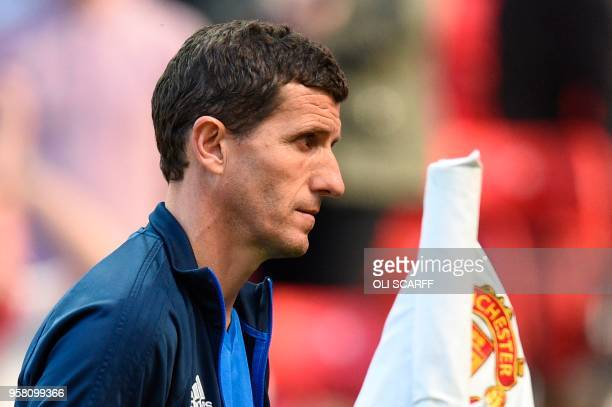 Watford's Spanish head coach Javi Gracia leaves at the end of the English Premier League football match between Manchester United and Watford at Old...
