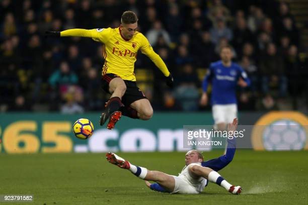 Watford's Spanish midfielder Gerard Deulofeu is tackled by Everton's English midfielder Tom Davies during the English Premier League football match...
