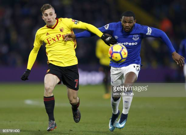 Watford's Spanish midfielder Gerard Deulofeu vies with Everton's Dutch defender Cuco Martina during the English Premier League football match between...