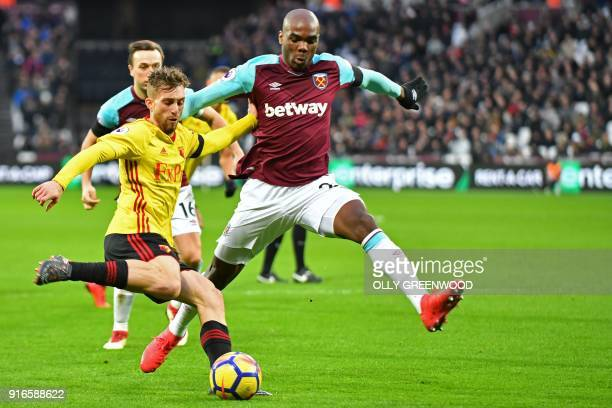Watford's Spanish midfielder Gerard Deulofeu vies with West Ham United's Italian defender Angelo Ogbonna during the English Premier League football...