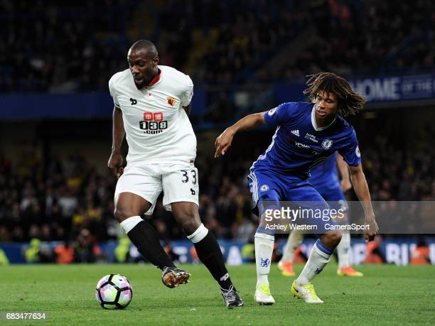 Watford's Stefano Okaka Chuka holds off the challenge from Chelsea's Nathan Ake during the Premier League match between Chelsea and Watford at...