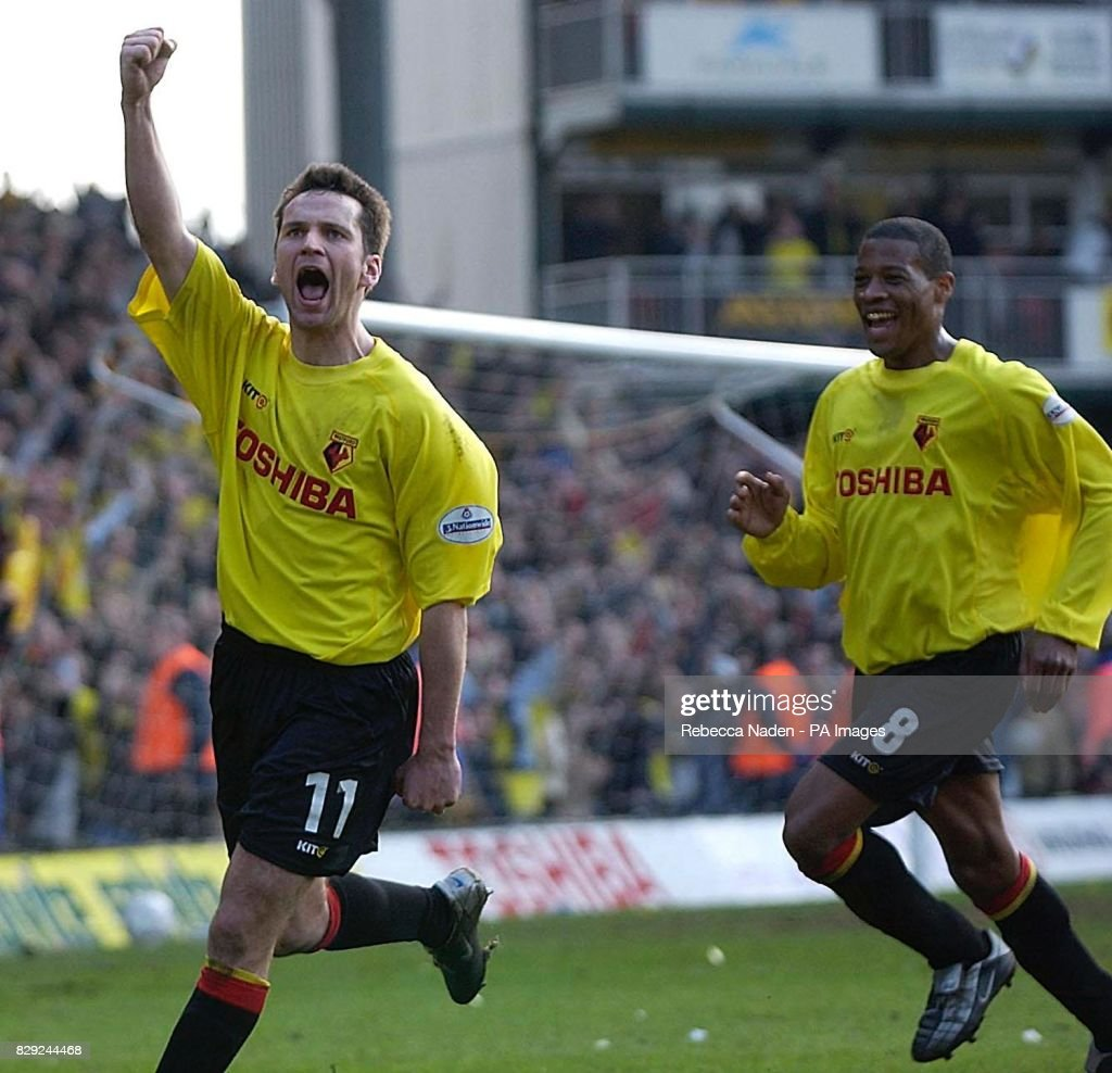 Watford's Stephen Glass celebrates scoring (left) with Micah Hyde, during their FA Cup 6th round match at Watford's Vicarage Road ground. THIS