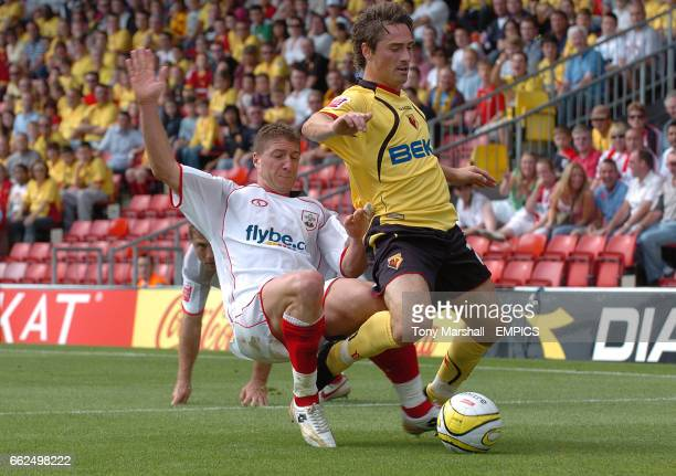 Watford's Tommy Smith tackled by Southampton's Gregory Vignal