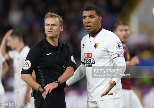 Watford's Troy Deeney and referee Michael Jones