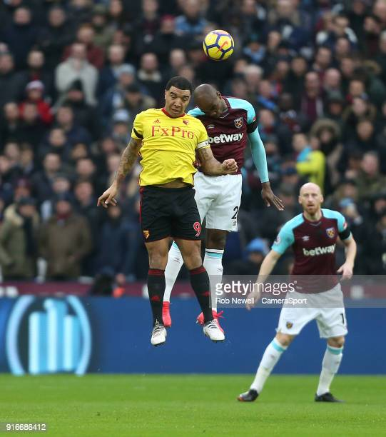 Watford's Troy Deeney and West Ham United's Angelo Ogbonna during the Premier League match between West Ham United and Watford at London Stadium on...