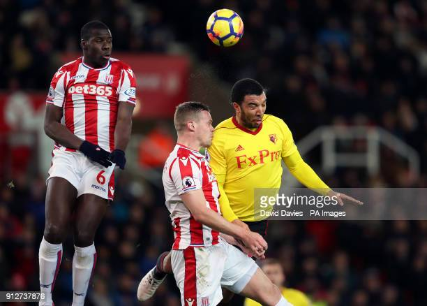 Watford's Troy Deeney battles with the ball in the air with Stoke City's Ryan Shawcross and Kurt Zouma during the Premier League match at the bet365...