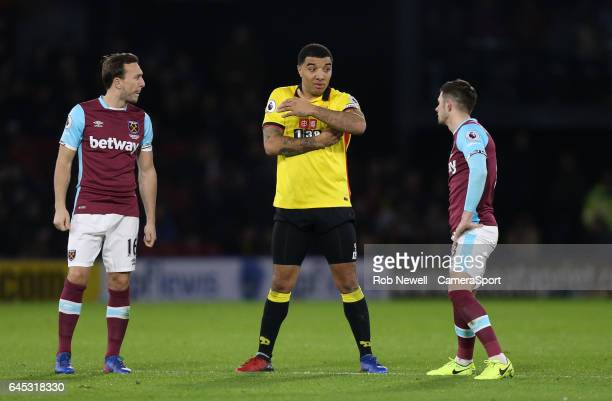 Watford's Troy Deeney in discussion with West Ham United's Aaron Cresswell and Mark Noble during the Premier League match between Watford and West...
