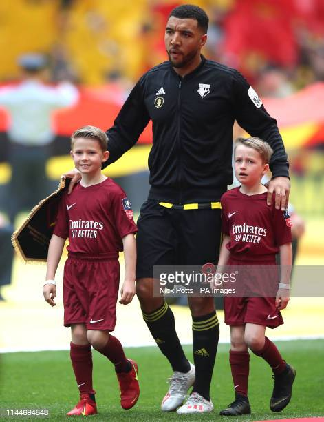 Watford's Troy Deeney walks out with mascots, Elton John and David Furnish's children Zachary and Elijah, prior to the FA Cup Final at Wembley...