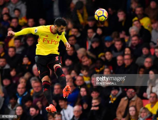 Watford's Uruguayan defender Miguel Britos heads the ball during the English Premier League football match between Watford and West Ham United at...