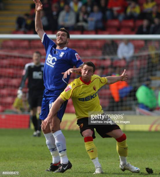 Watford's Will Hoskins and Birmingham City's Franck Queudrue during the CocaCola Championship match at Vicarage Road Watford