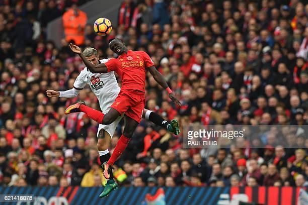 TOPSHOT Watford's Yugoslavianborn Swiss midfielder Valon Behrami vies in the air with Liverpool's Senegalese midfielder Sadio Mane during the English...